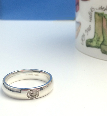 Silver heavy court wedding ring with thistle motif